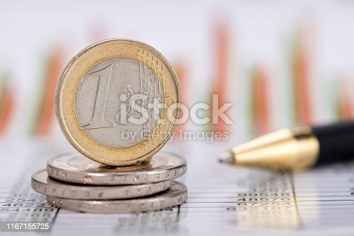 istock stacked coins of Euro currency on financial chart 1167155725