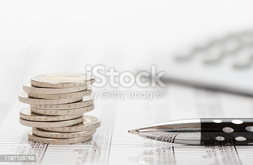 istock stacked coins of Euro currency on financial chart 1167155768