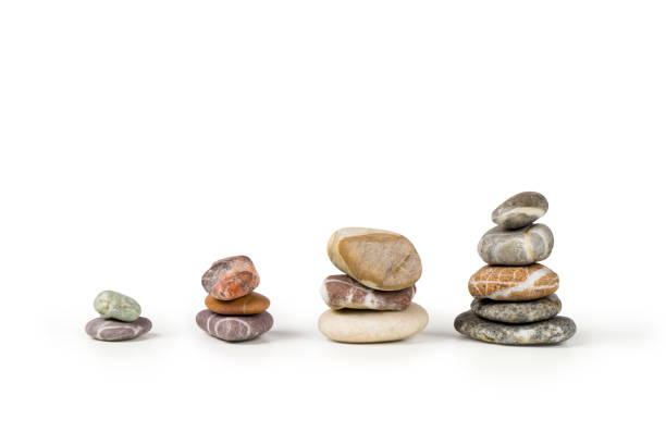 Stacked colorful pebbles financial growth business chart. stock photo