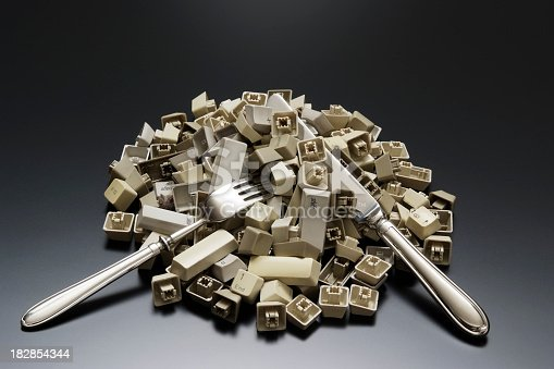 176074170 istock photo Stacked computer keyboard keys with silverware on office desk 182854344