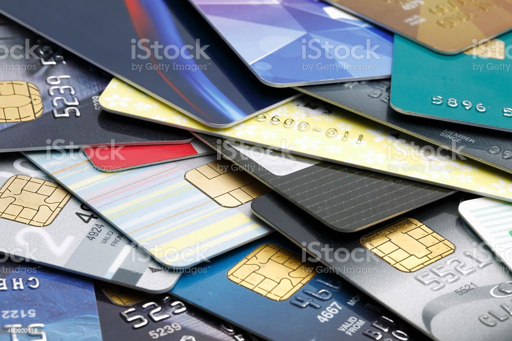 Stacked credit cards Colorful stack of credit cards and shopping gift cards. Macro with extremely shallow dof. 2015 Stock Photo