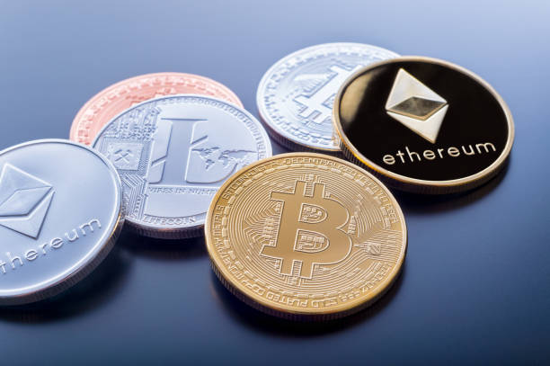 Stacked cryptocurrency coins stock photo