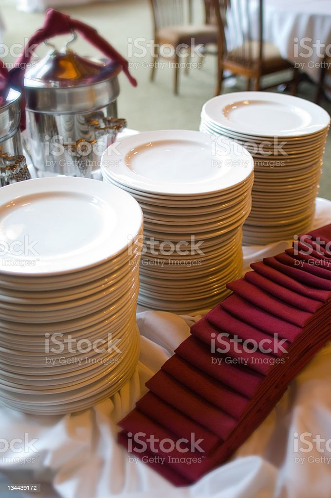 Stacked Dinner Plates at a Buffet With Napkins royalty-free stock photo