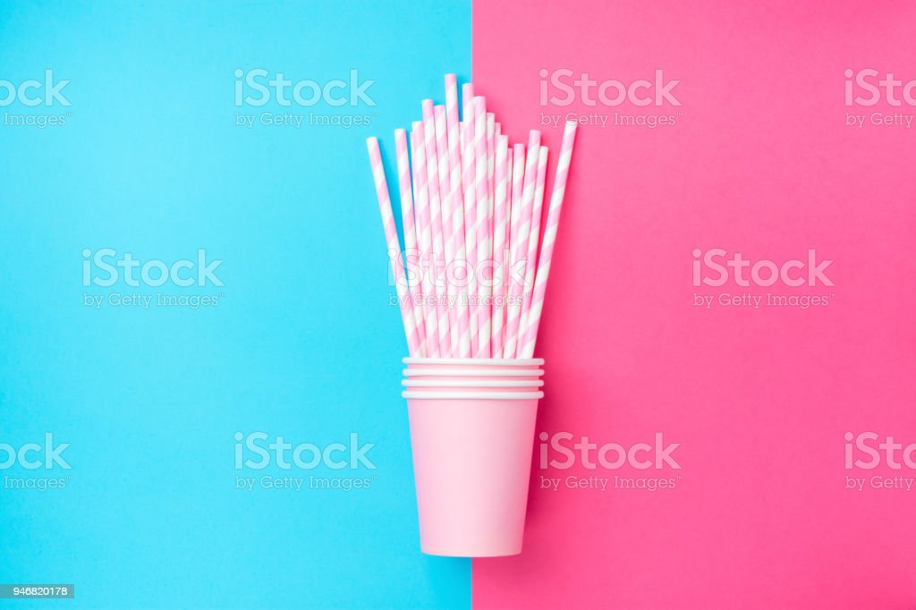 Stacked Drinking Paper Cups with Striped Straws on Duo Tone Mint Blue Pink Background. Flat Lay. Birthday Party Celebration Kids Fun. Greeting Card Poster Template. Copy Space stock photo