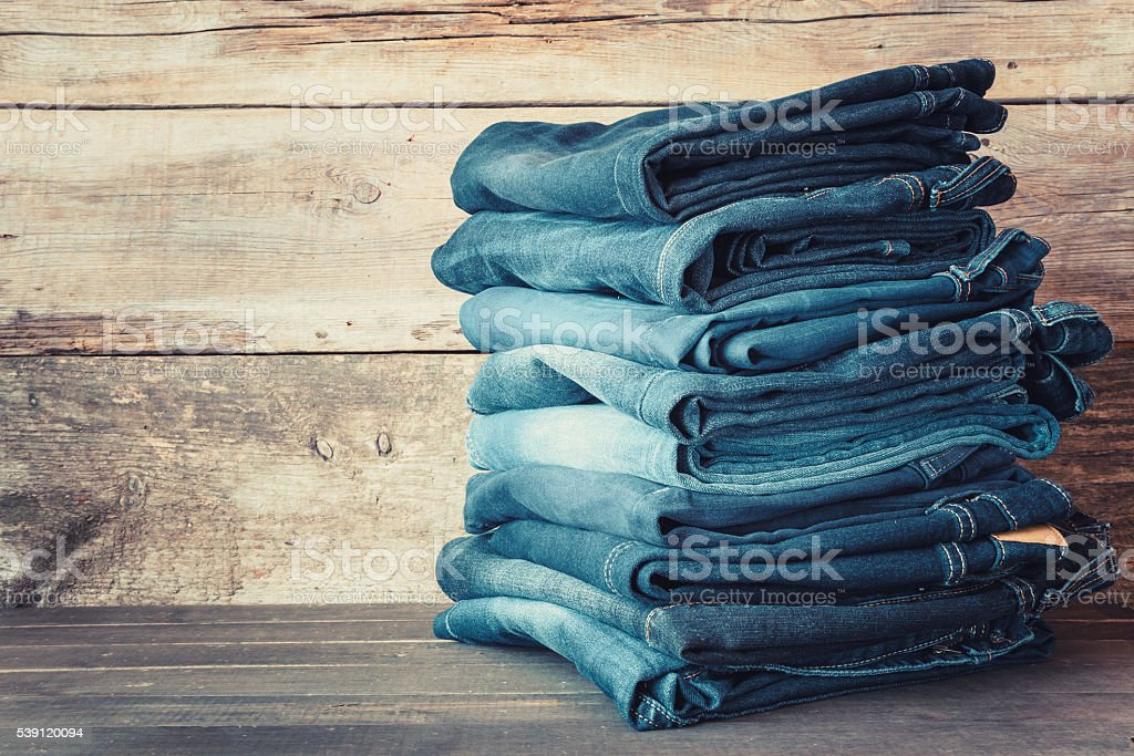 Stacked fashion blue jeans stock photo