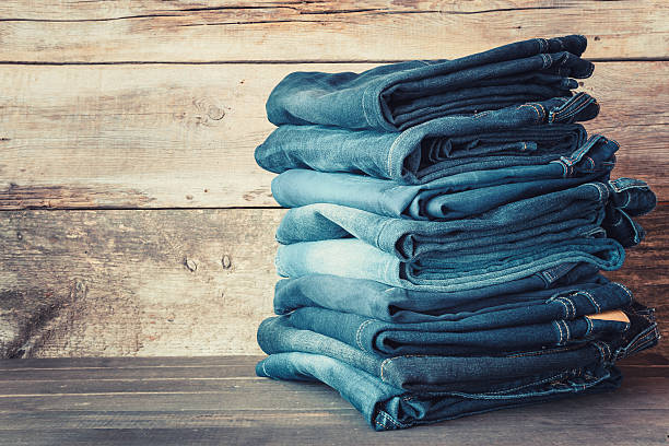 stacked fashion blue jeans - jeans stock photos and pictures