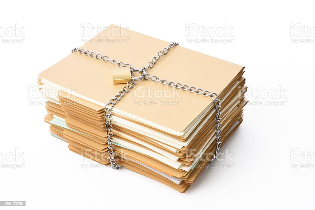 Stacked file folder and tied up chain with locked padlock stock photo
