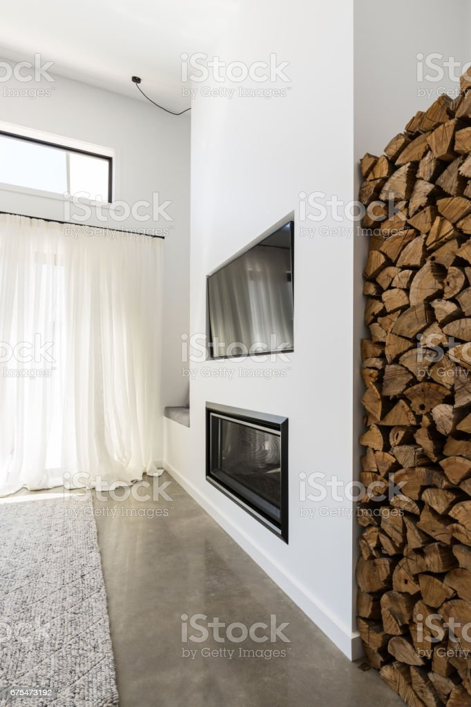 Stacked Firewood Alcove Next To Living Room Tv And Fireplace   Stock Image .