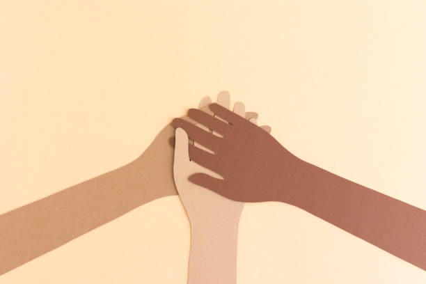 Stacked flat diverse hands Diverse paper hands of different color holding hands together in team concept demonstrating unity, diversity unity stock pictures, royalty-free photos & images