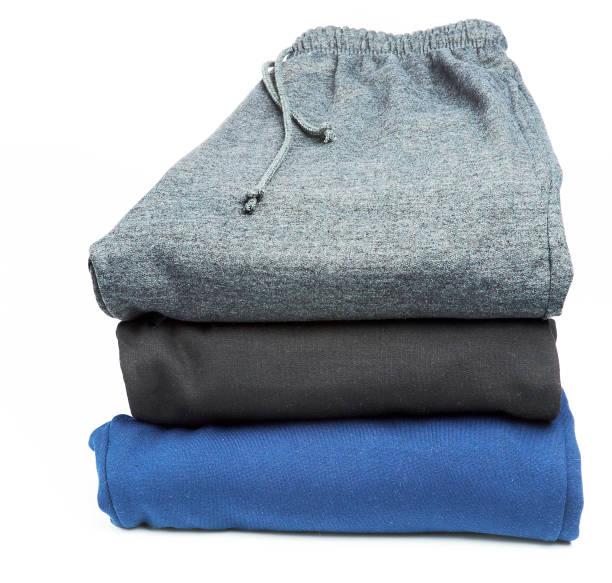 gestapelte fleece-hose - sweatpants stock-fotos und bilder