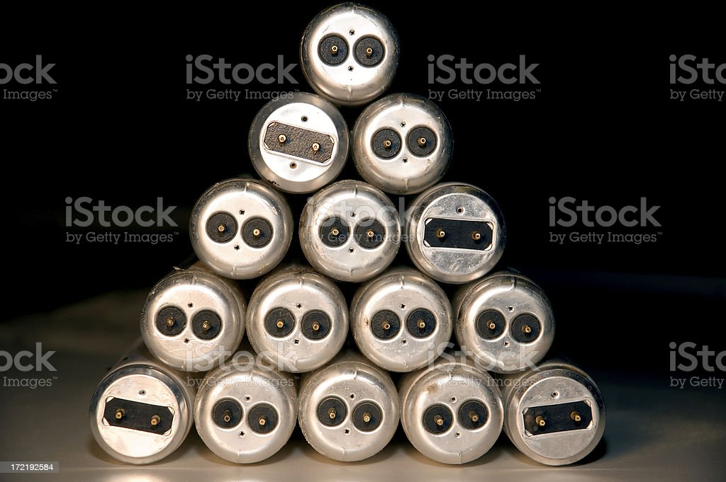 Stacked fluorescent bulb ends royalty-free stock photo