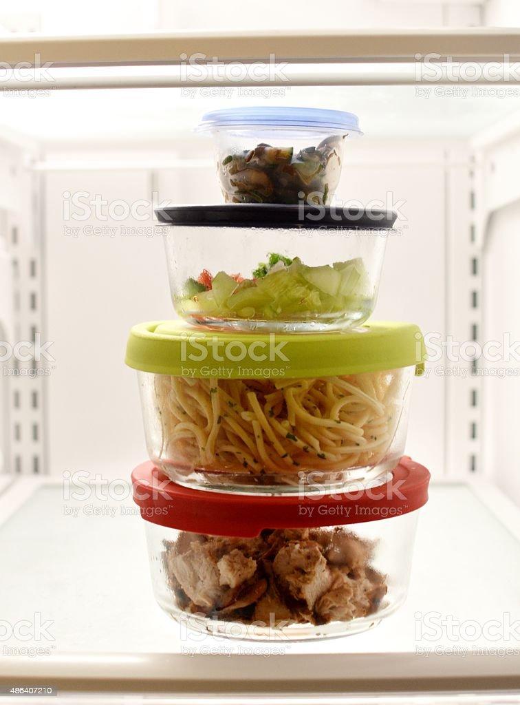 Stacked Leftovers in Fridge stock photo
