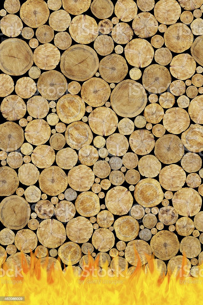 Stacked Logs Background in fire stock photo
