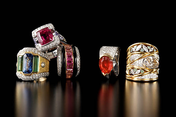 stacked luxury ring on black background with copy space - ring jewelry stock photos and pictures