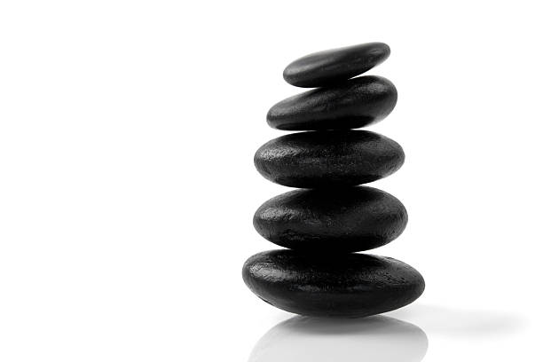 Stacked massage stones stock photo