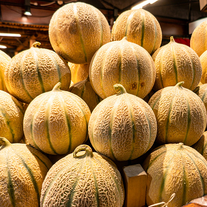 pile of melons on a stall at the market
