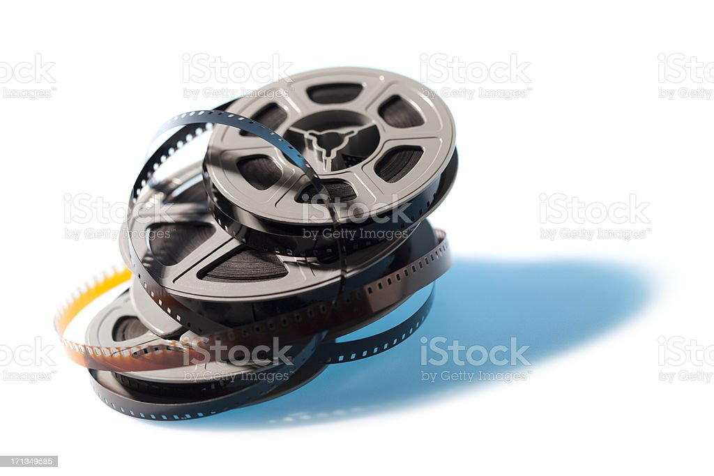 Stacked movie film reels with blue shadow royalty-free stock photo