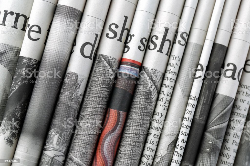 Stacked newspaper headlines stock photo