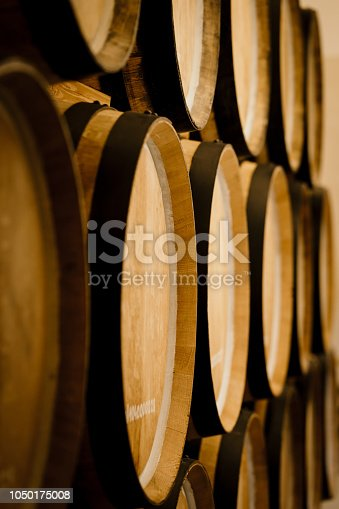 Oak barrels. Wine barrels stacked in the cellar of the winery.