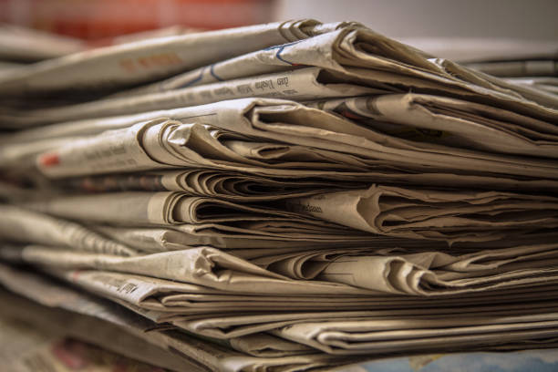 Stacked old news paper Stacked old news paper on the table waiting for recycles news stand stock pictures, royalty-free photos & images