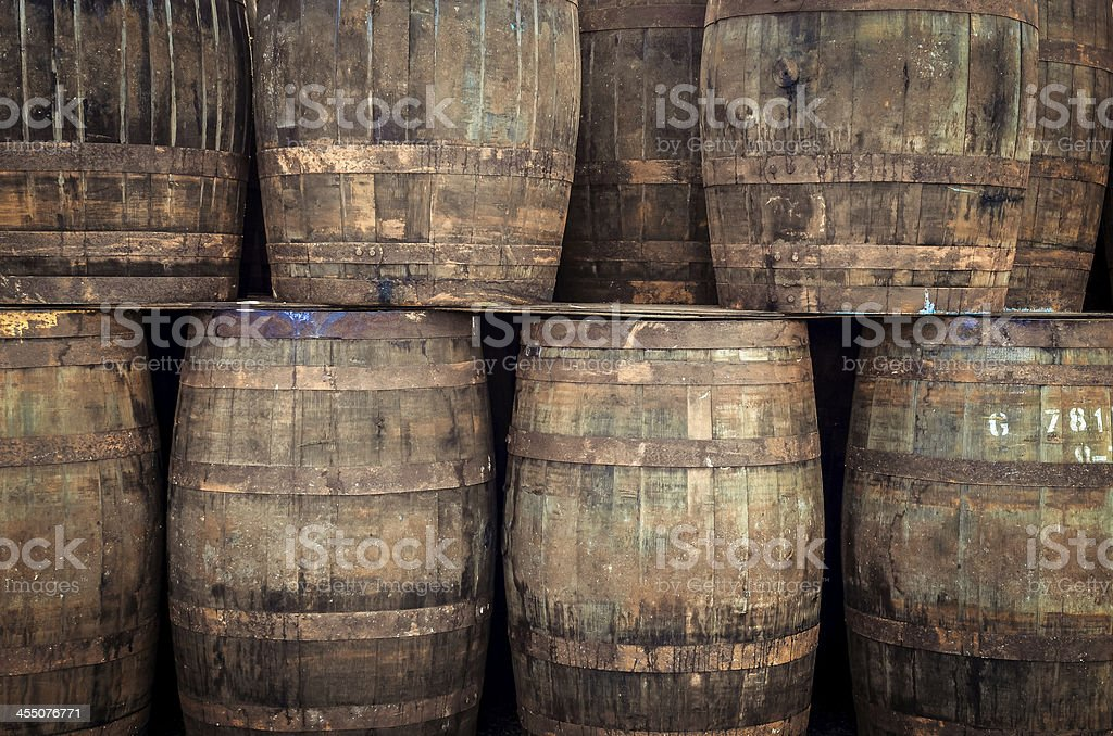 Stacked old whisky and wine barrels stock photo