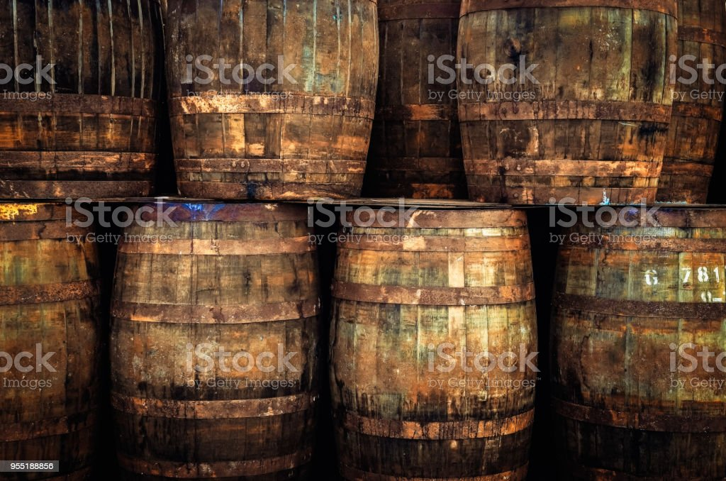 Stacked old whisky barrels stock photo