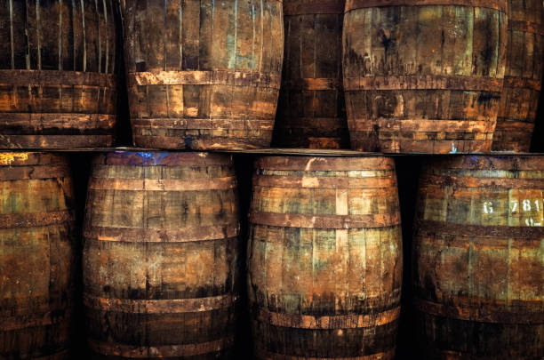 stacked old whisky barrels - cask foto e immagini stock