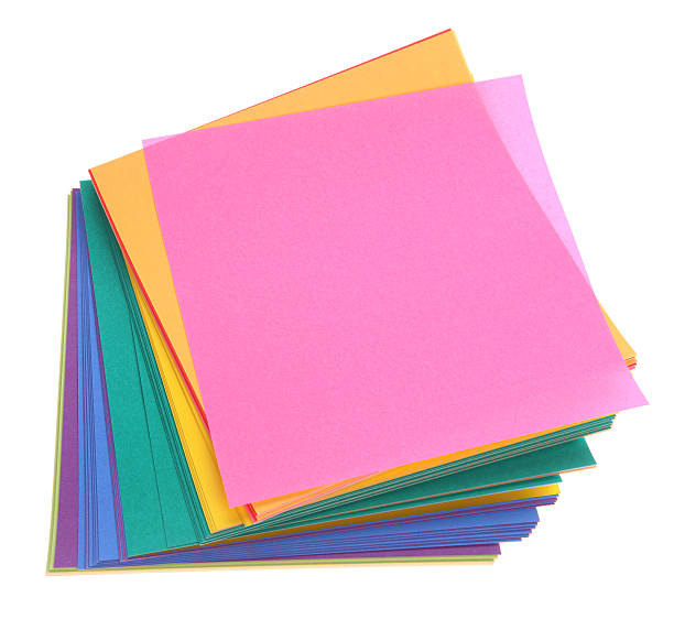 Stacked Paper - Square Colored Paper on White Background stock photo