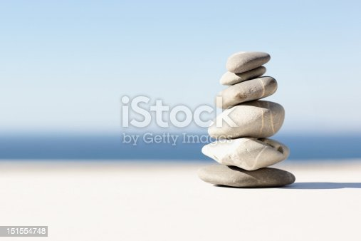 istock Stacked pebbles closeup on a beach 151554748