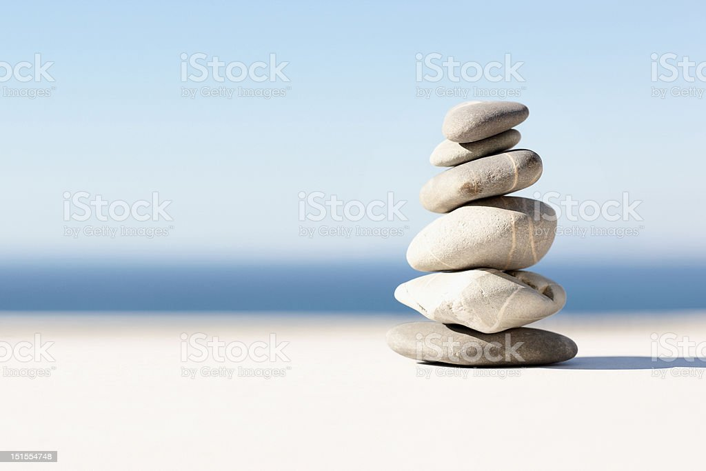 Stacked pebbles closeup on a beach stock photo