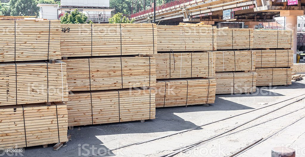 stacked piles of timber product stock photo