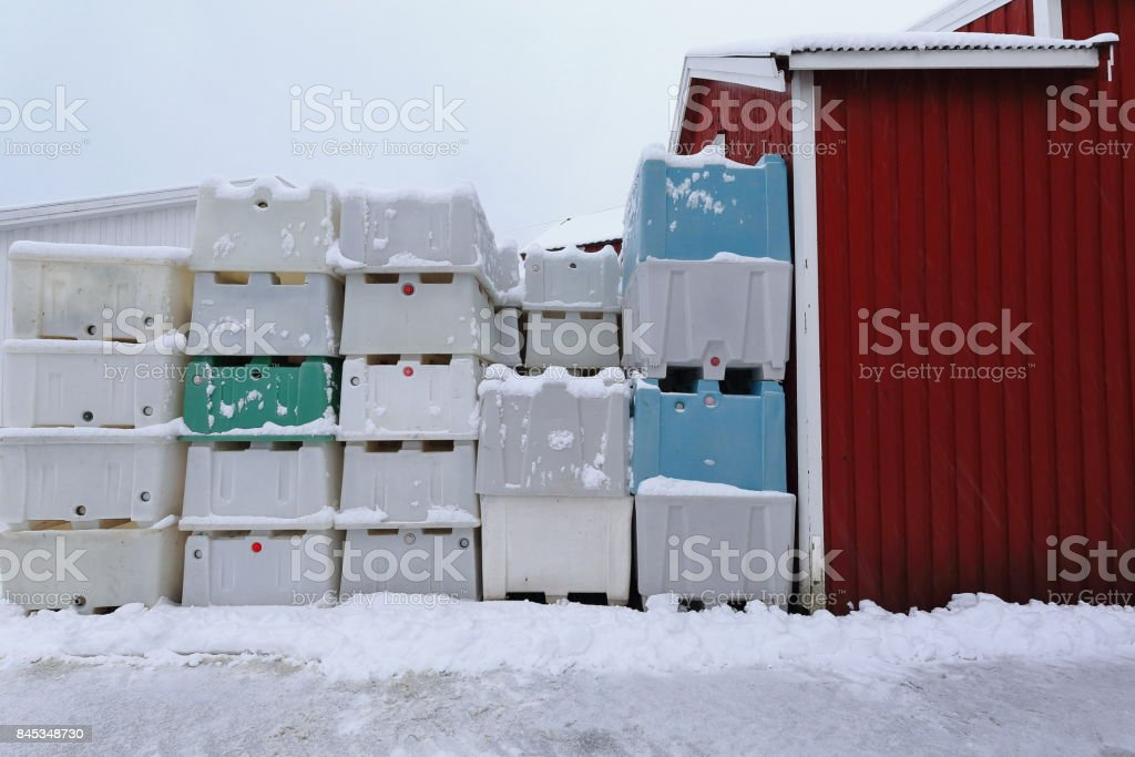 Stacked plastic pallet boxes for fish storage-port warehouse. Hamnoy-Reine-Lofoten-Norway. 0392 stock photo