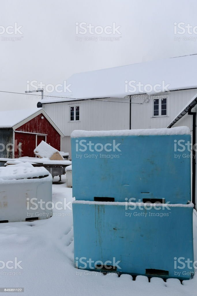 Stacked plastic pallet boxes for fish storage-port warehouse. Hamnoy-Reine-Lofoten-Norway. 0393 stock photo