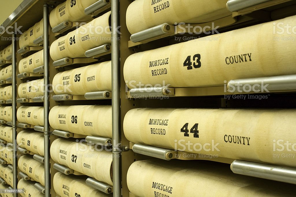 Stacked records of mortgage records stock photo