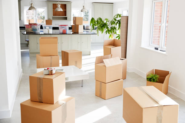 Stacked Removal Boxes In Empty Room On Moving Day stock photo