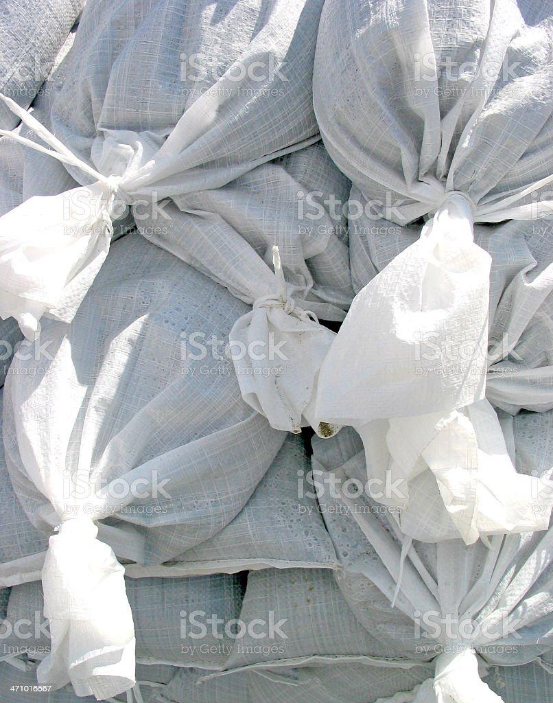 Stacked sandbags stock photo