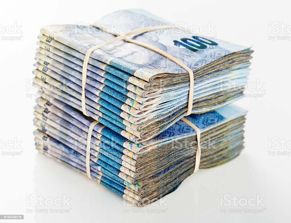 Stacked South African Hundred Rand banknotes worth tens of thousands stock photo