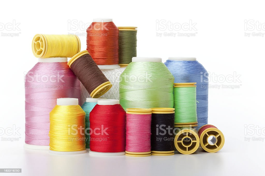 Stacked spools of thread royalty-free stock photo