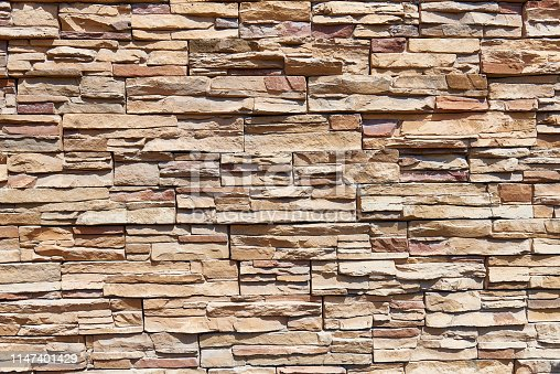 istock Stacked stone wall background horizontal. 1147401429