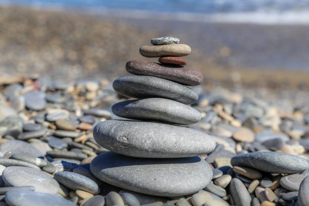 Stacked stones center of focus on a beach stock photo