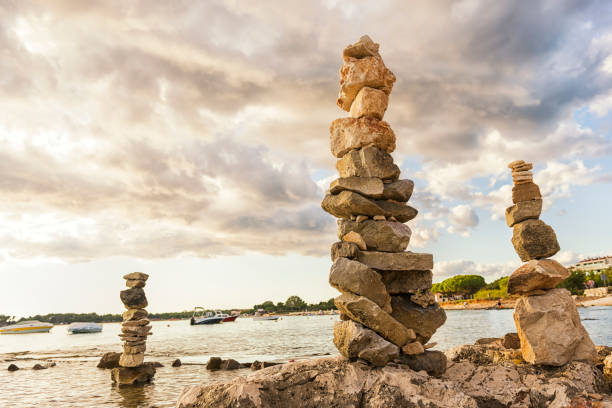 stacked stones in balance - stack rock stock pictures, royalty-free photos & images