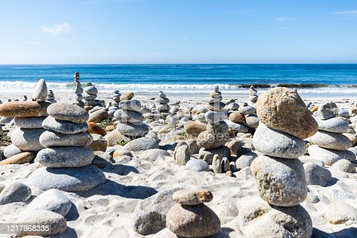 186803914 istock photo Stacked Stones on a beach in California USA 1217968335