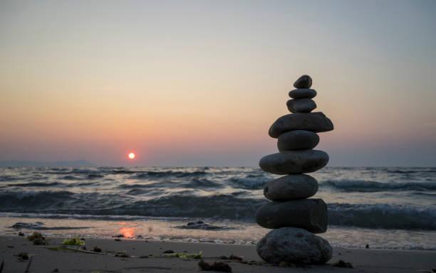 Stacked Stones on the Beach at Sunset, Kabatepe, Çanakkale, Turkey stock photo
