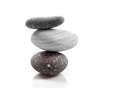 Stacked stones on white background