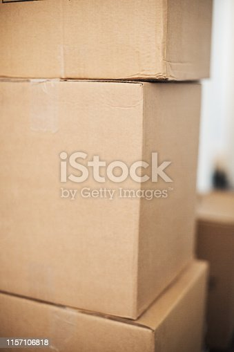 A stack of filled, taped-up cardboard cartons