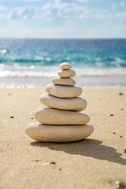 Stacked tower of balancing smooth pebbles. stock photo