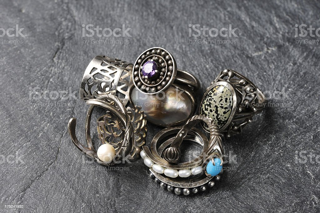 Stacked unique silver ring on slate royalty-free stock photo