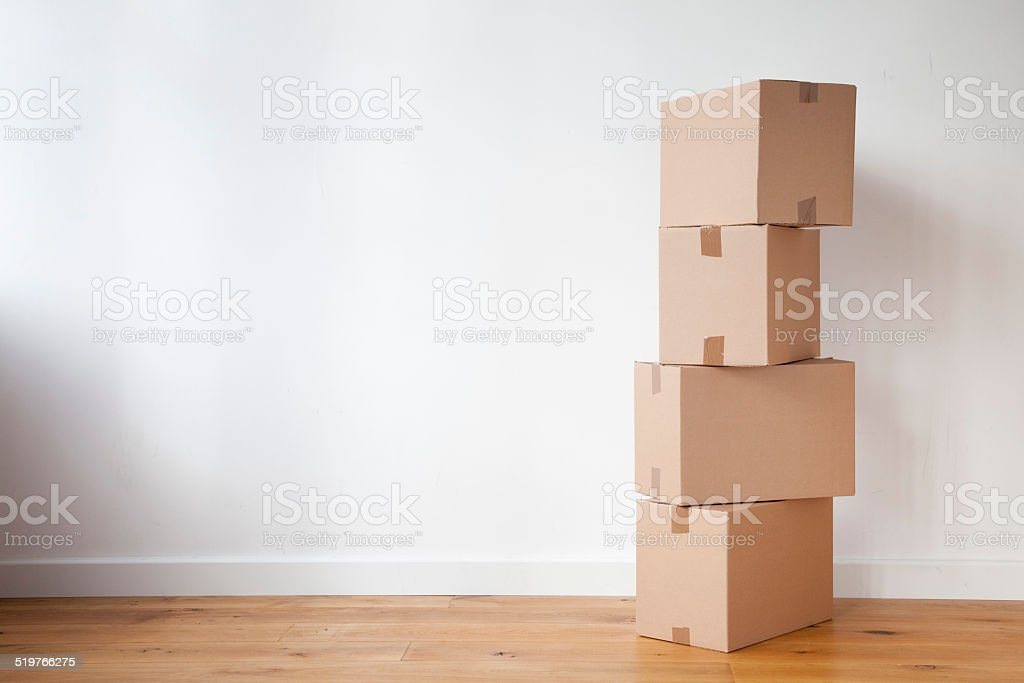 Stacked up moving boxes stock photo