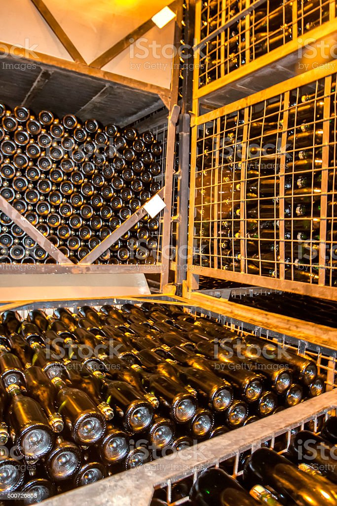 Stacked Up Wine Bottles In The Cellar stock photo