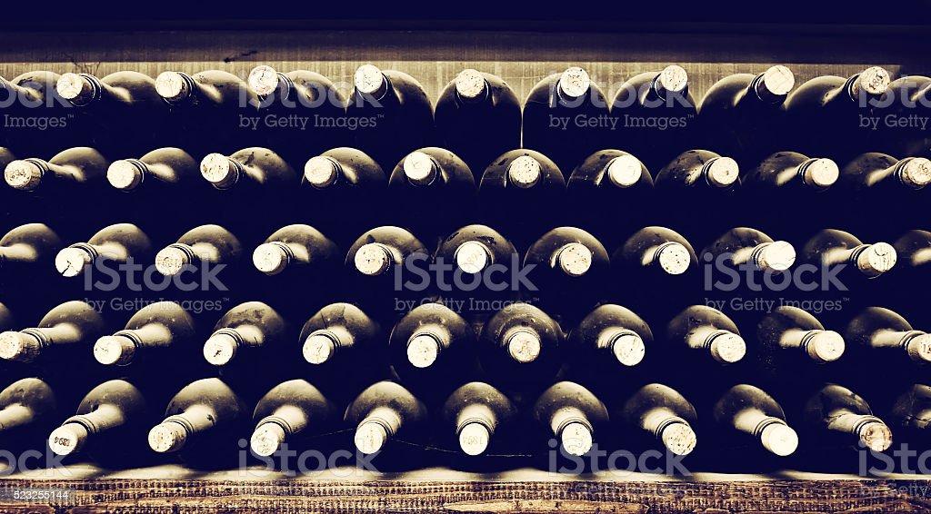 Stacked up wine bottles stock photo